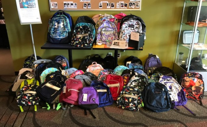 several backpacks in boston office, collected by employees